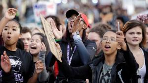In this Nov. 14, 2016 file photo, students from Garfield High School march to rally with other students who walked out to protest the election of Donald Trump as president in Seattle. (AP Photo/Elaine Thompson, File)